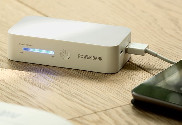Power Bank Branded Gift charging an iPad.