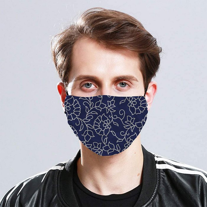 Front view of a blue example of the face cover being worn