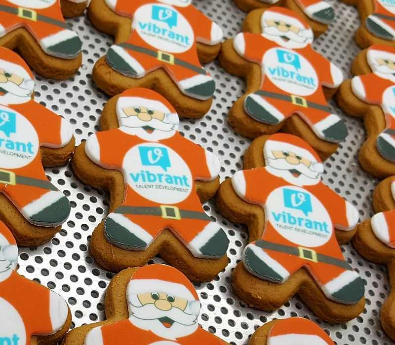 Promotional Shortbread Santa shapes with Logo Printing on the baking tray