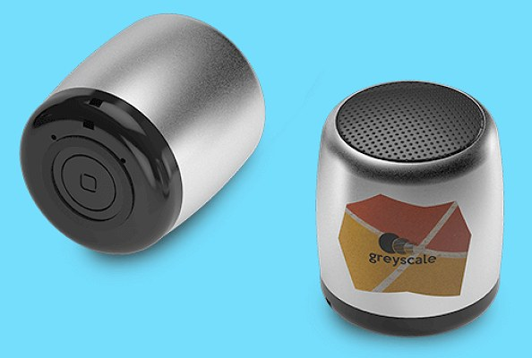 Tiny bluetooth speakers showing the control button on the base