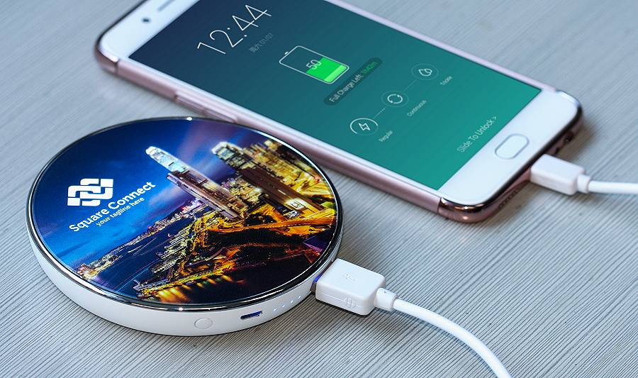 Express Wireless Power Bank Chargers charging a Samsung mobile